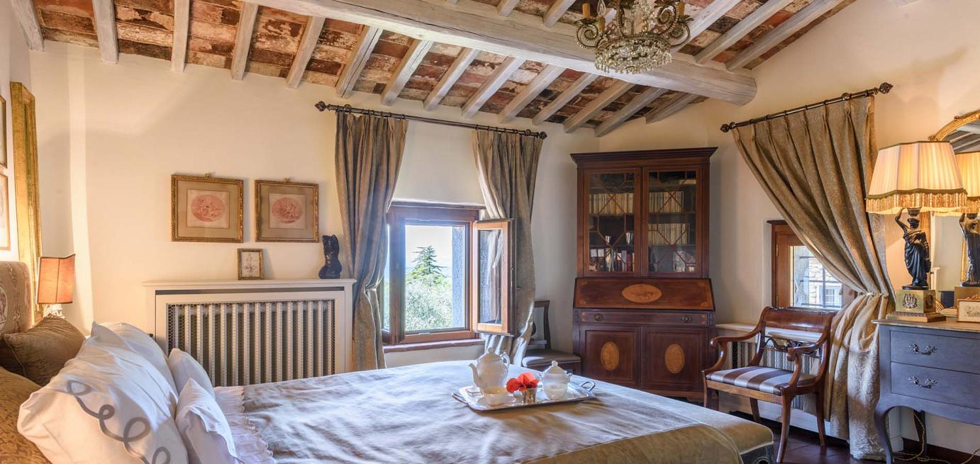 Luxury bedroom interior of Tuscany holiday villa